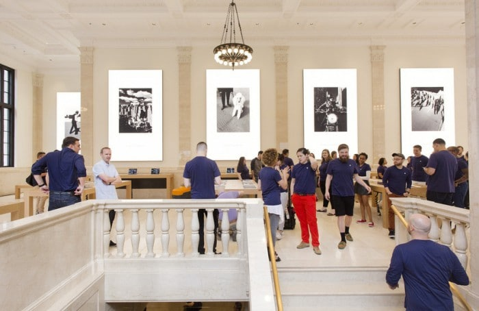 Apple employees gather in the company's new store, Thursday, June 11, 2015, on New York's Upper East Side. The new store, scheduled to open Saturday, occupies part of a Beaux Arts building that originally housed the U.S. Mortgage & Trust bank. Apple sought to restore some of the building's old grandeur by reproducing the original chandeliers seen in old photographs, restoring marble floors and pilasters and turning a bank vault into a VIP showroom. (AP Photo/Mark Lennihan)