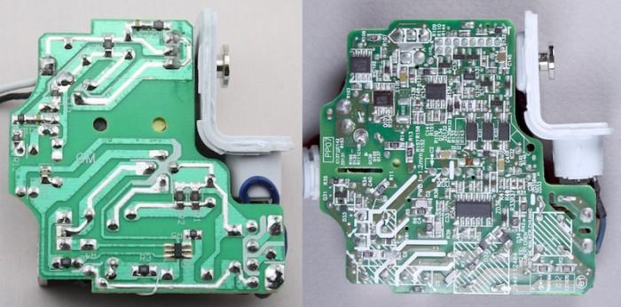 Kép: Hamisított és eredeti MacBook töltő összehasonlítása, a hamisított töltő esetén egyértelmű a végletekig leegyszerűsített elektronika.
