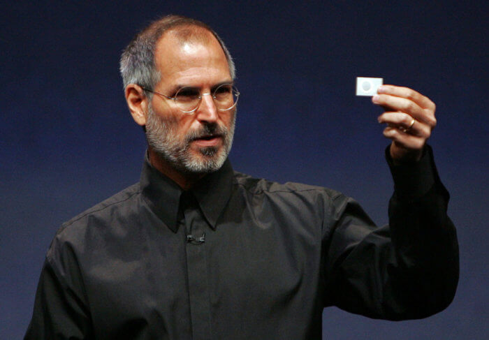 SAN FRANCISCO - SEPTEMBER 12: Apple CEO Steve Jobs holds up a new iPod Shuffle as he delivers a keynote address during an Apple media event September 12, 2006 in San Francisco. Jobs announced new iPods and video downloads from iTunes as well as a sneak peek at a device tenatively called iTV which allows you to channel iTunes to your television and is expected out in early 2007. (Photo by Justin Sullivan/Getty Images) *** Local Caption *** Steve Jobs ORG XMIT: 71862489